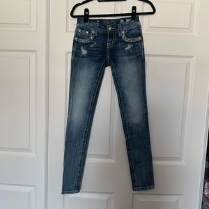 Woman's miss me skinny bling jeans